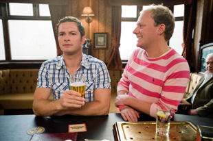Andrew Langtree, left, enjoys a pint at The Rovers Return