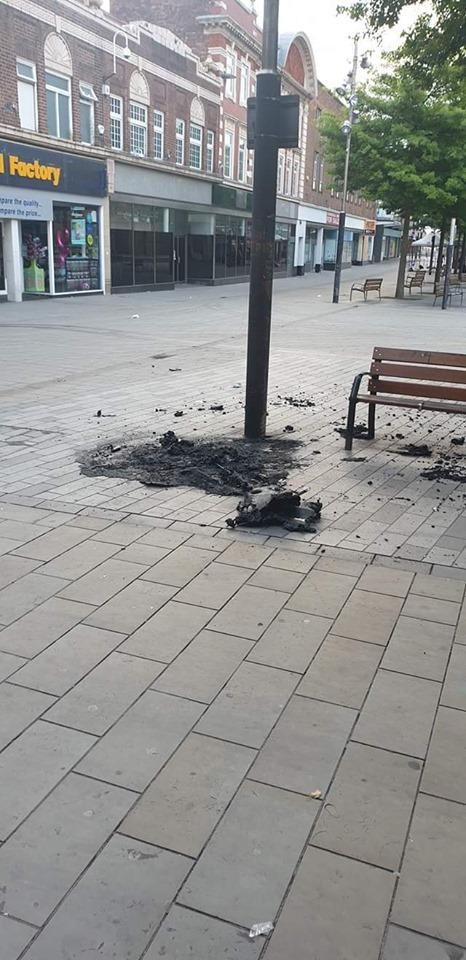The bin was torched on Church Street Pic: St Helens Police