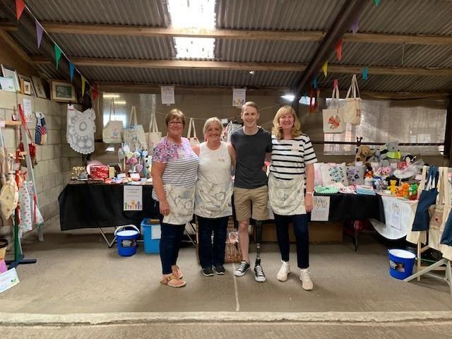 Chris with members of the club at their stall at Inglenook Farm, Rainford