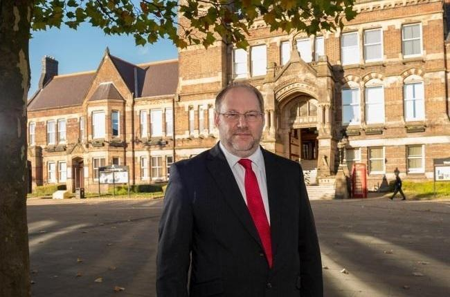 Cllr Derek Long outside St Helens town hall