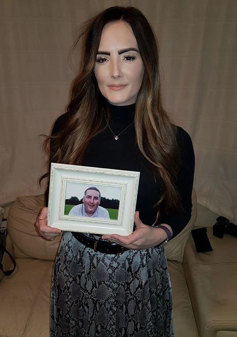Laura with a picture of her dad