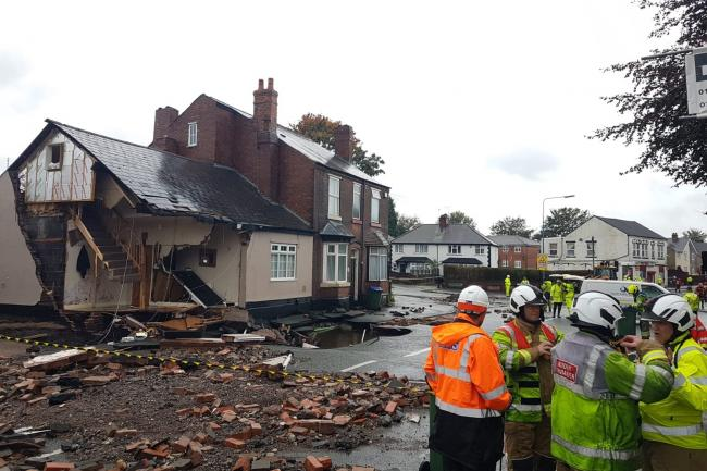 Burst water main causes house to partially collapse
