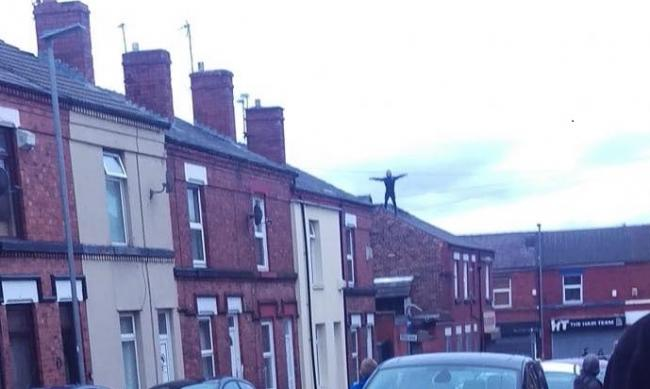 Police in attendance as wanted man climbs on roof on Cambridge Road