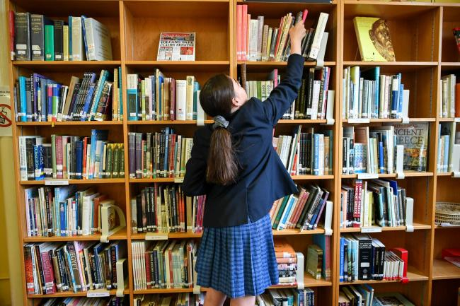 School pupil in library
