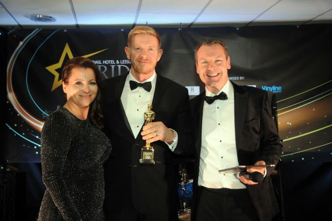 Rob Vaughan, 46, centre, holding his award proudly alongside sponsor Allie Baglow and host Fraser Dainton