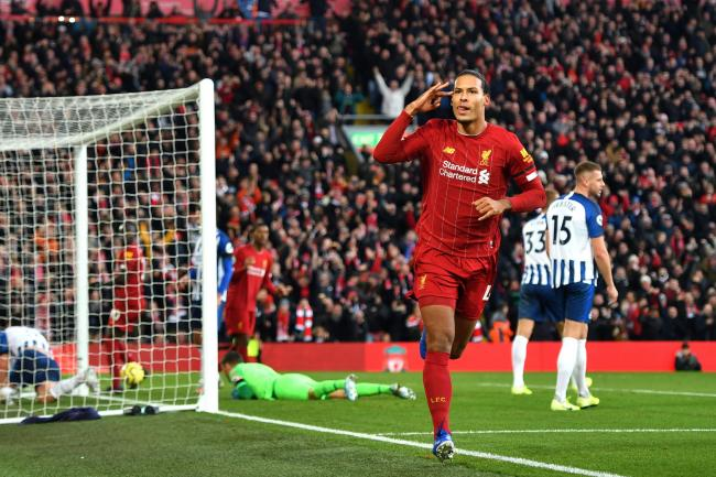 Liverpool's Virgil van Dijk celebrates scoring his side's first goal during the Premier League match at Anfield, Liverpool, on Saturday. Table toppers Liverpool face Everton in the Merseyside derby on Wednesday. Picture: Anthony Devlin/PA Wire.