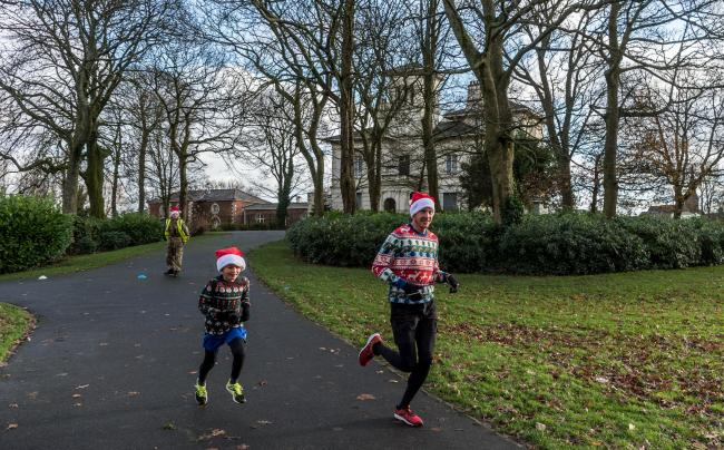 PICTURED: Last year's Santa Dash in Victoria Park, which saw father and son, Chris and Bobby Birkett the first over the line
