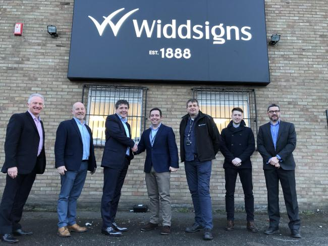 St Helens Council leader David Baines (centre) and cabinet member for economic regeneration and housing, Cllr Richard McCauley (third from right) were invited down to Widdsigns based on the Reginald Road Industrial Estate in Sutton