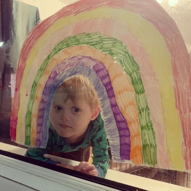 Hugo aged 4, our own little rainbow with the rainbow he made with his brothers. In our front window in grange park, They have also painted a large one on upstairs side window!