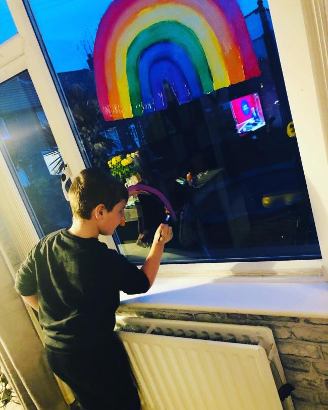 Archie painting his rainbows.
