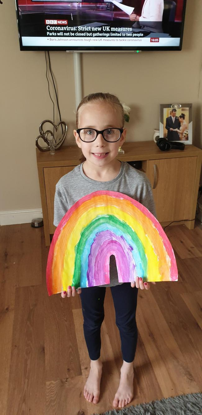 Lucy Hunter aged 7 with her rainbow before we put it in the window to make people smile