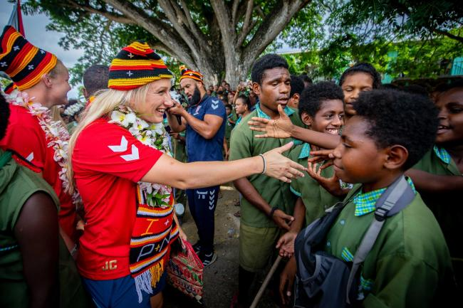 Jodie Cunningham meeting the locals in Papua New Guinea last year while on tour with England