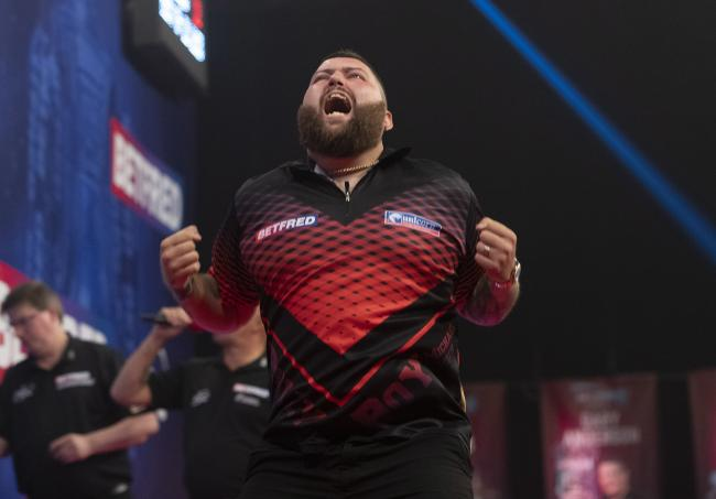 Michael Smith shows what the Betfred World Matchplay title chase means to him. Picture: Lawrence Lustig
