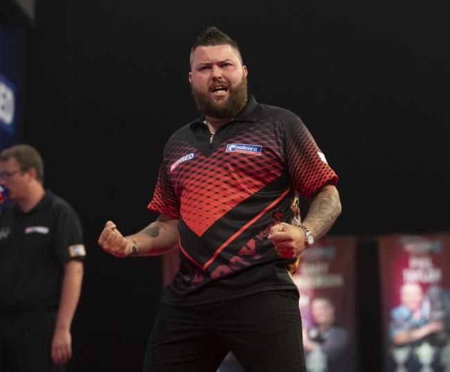Michael Smith on his way to the World Matchplay seni-finals. Picture: Lawrence Lustig
