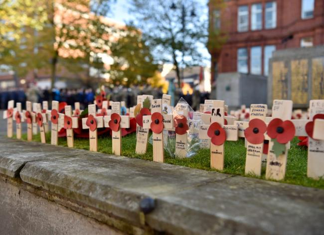 Crosses planted last year at the war memorial in St Helens