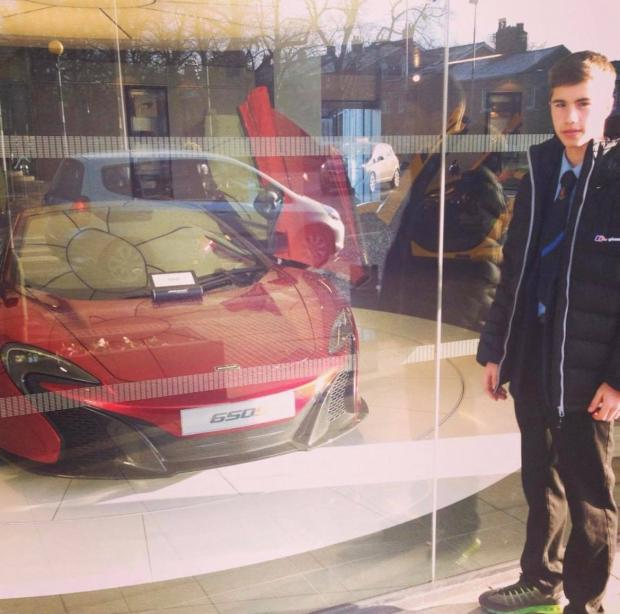 St Helens Star: Liam in De La Salle's time pictured with expensive sports car