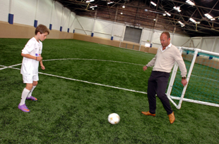 Sure footed: Alan Shearer makes the play with young Tom Marshall.