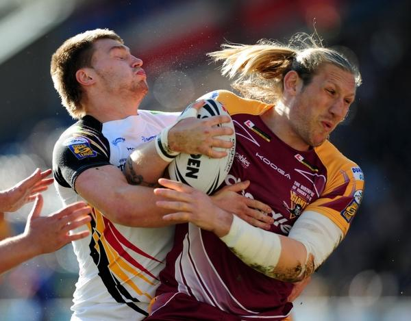 St Helens Star: Elliott Whitehead tackles man mountain Eorl Crabtree