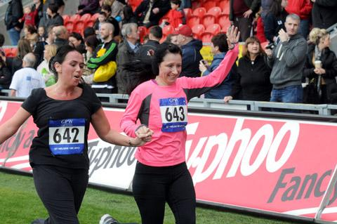 Two runners head for the finish line at last year's St Helens 10K.
