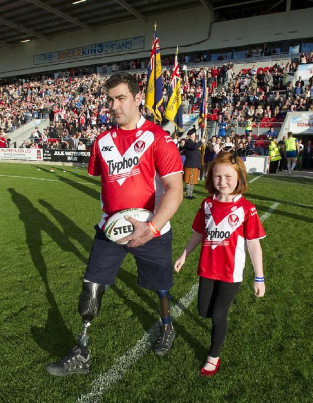 Andy Reid pictured carying the match ball at Langtree Park ahead of a game that raised funds for The Soldiers' Charity.