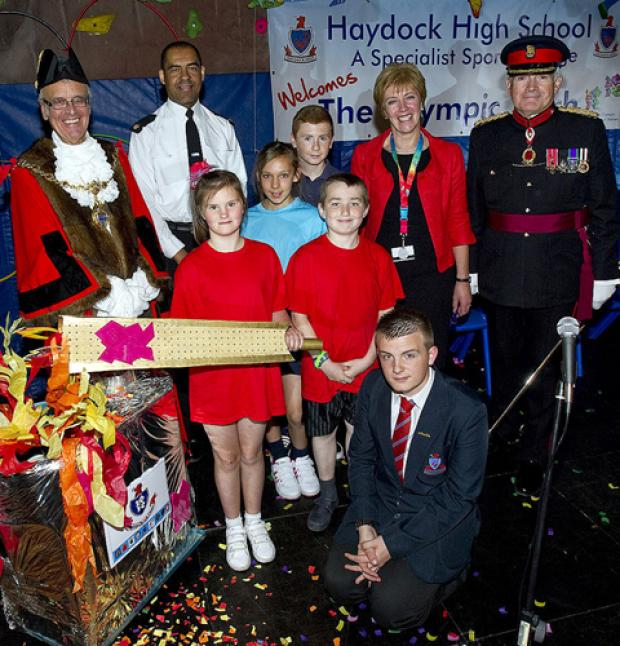 Students, teachers and dignitries celebrate Haydock Sports College's Olympic community project.