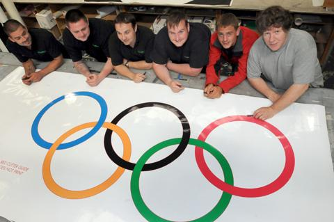 Olympic icons: (pictured left to right) Vinyline workers Stu Hitchen, Dab Critchley, Dean Meredith, Phil Picton, Sam Heyes and Glyn Davies have been producing graphics for London 2012.