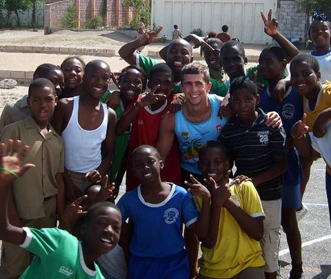 Teacher Danny Lynch takes a class at a Jamaican school during the BARLA Cougars rugby league tour