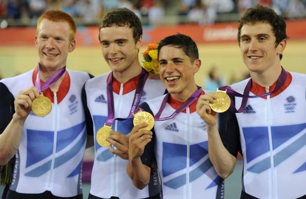 Ed Clancy, left, and the team with their gold medals. Picture by Tom Jenkins/NOPP