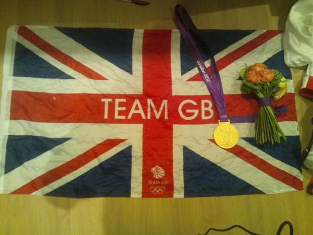 Pride of Britain: Ed Clancy shared this image, of his gold medal and a flag he was given by the crowd, with his Twitter followers.