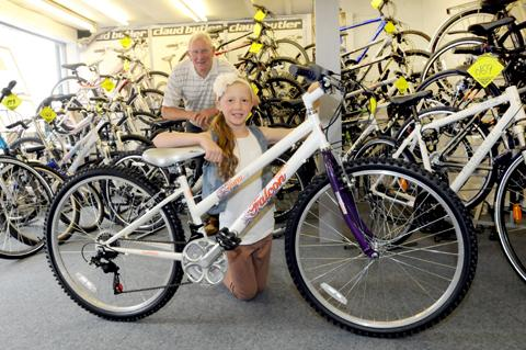 Elleanor Anders receives her bike from Brian Bromilow.