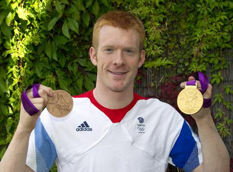 Ed Clancy, at home in Newton-le-Willows, with his Olympic medals. (Picture by Bernard Platt)