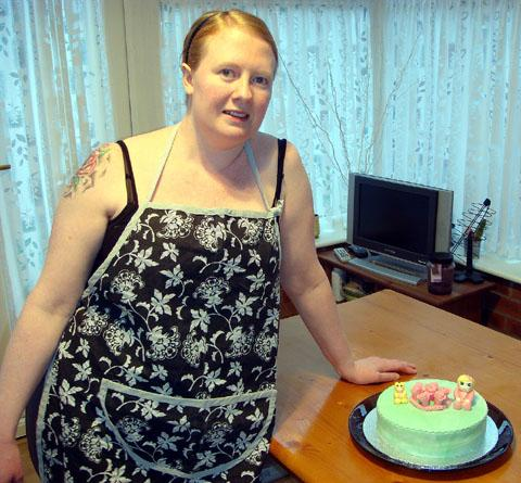 Tracy showing off her cake-making skills three years ago when she weighed in at more than 12 stone