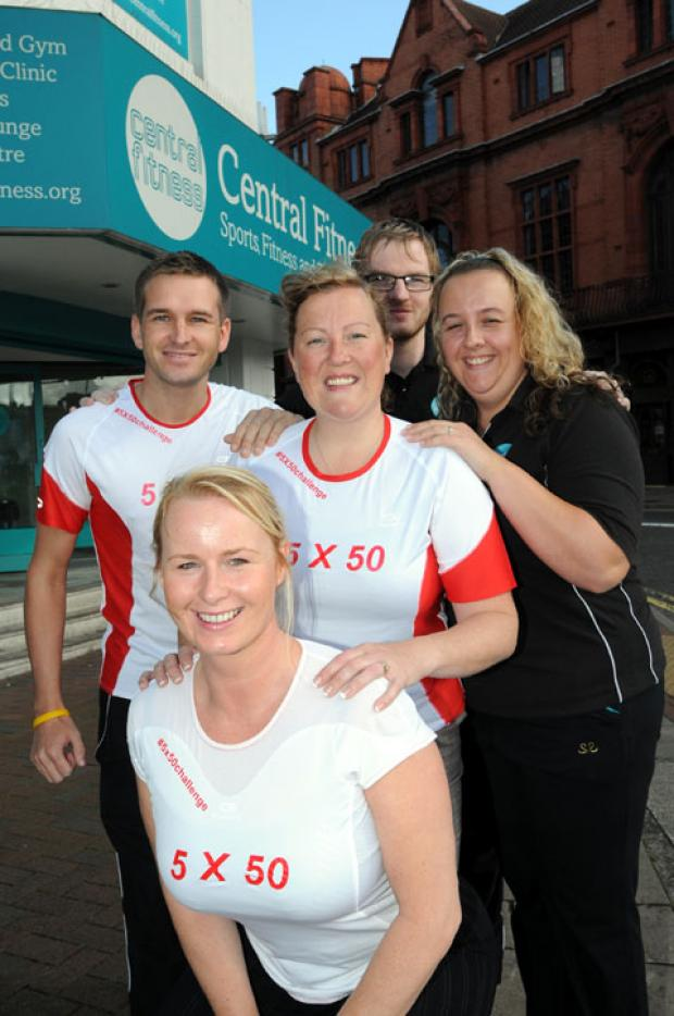 Zoe Donoghue (front) and Dawn Holden, members of the Star's promotions team, have signed up for the 5x50 challenge. They are pictured with Central Fitness staff