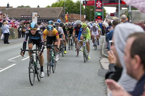 Tour de France champion Bradley Wiggins in full flow on Main Street, Billinge, where large crowds gathered. Picture by BERNARD PLATT