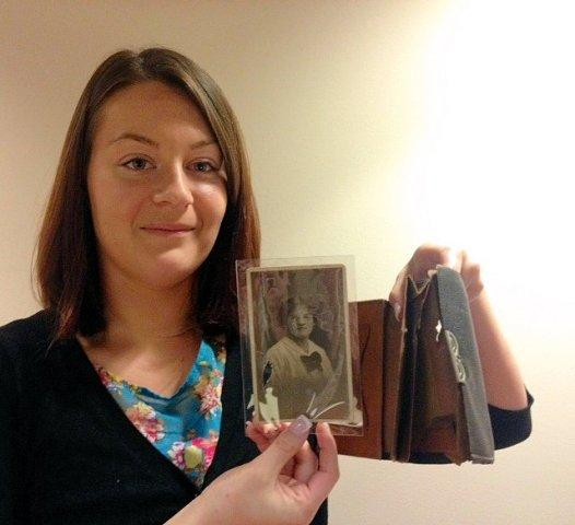 Bulletproof...Hannah Longworth displays the wallet that saved a St Helens soldier's life in the First World War.