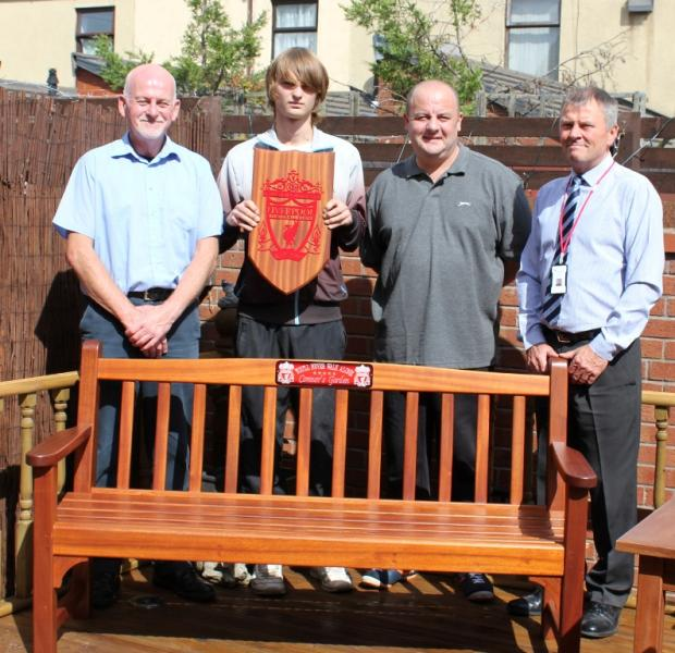 St Helens Star: Carpentry and joinery tutor Dave Cain with student Ryan Corless, Connor's dad Stephen Williams and Steve Smith, tutor in environmental technologies