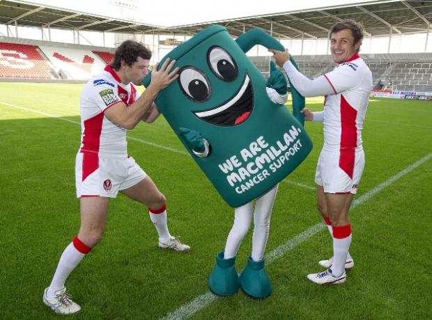Macmillan's mascot Muggy with Paul Wellens and Jon Wilkin.