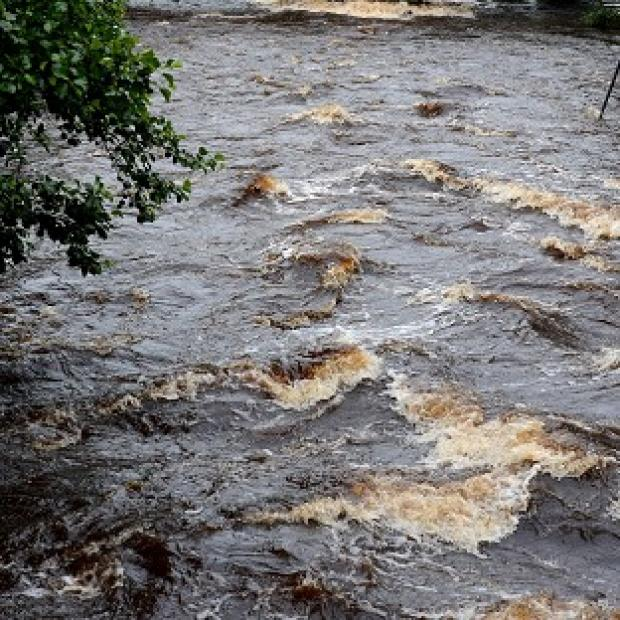 Two bodies have been found in the swollen River Clywedog near Wrexham in North Wales (PA)