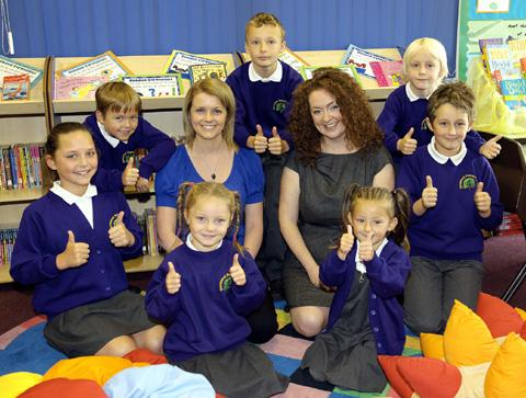 Pam Potter Head Teacher of Garswood Primary with year six teacher Lesley Moon and pupils.