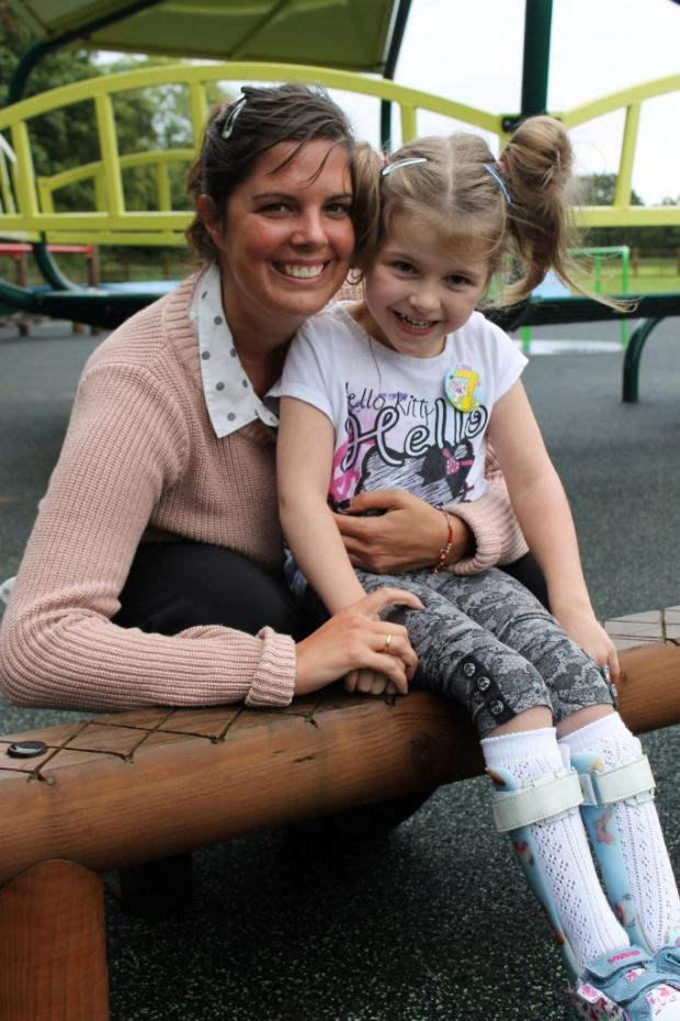 Our little star...Nicole Walker-Littler with Sonia Harris, fundraising officer with Legacy Rainbow House.