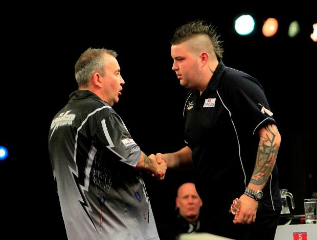Phil Taylor congratulates Michael Smith for his display
