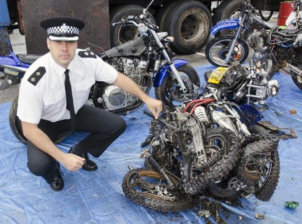 Merseyside Police Inspector Phil Ross with a scrambler which has been seized.
