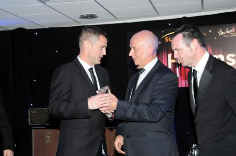 Star editor Steve Leary presents the award to Steve Prescott, who collected it on behalf of Eamonn McManus.