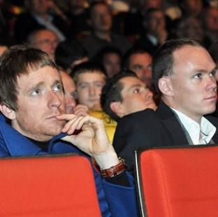 St Helens Star: Bradley Wiggins, left, and Chris Froome look on during the 2013 Tour de France Presentation in Paris