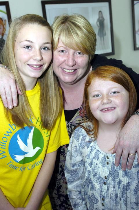 Ellie Jackson with mum Jane and sister Millie