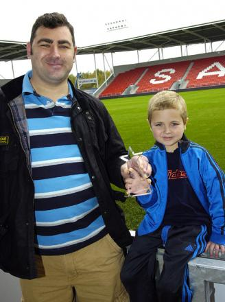 ANDY Reid presents Billy Jarvis with his award at Langtree Park.