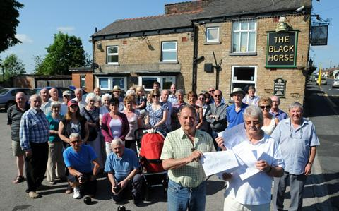 Moss Bank residents protest over the closure of the Black Horse earlier this year.