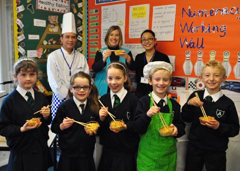 PICTURED: Back (l-r) Sam Yau of Pacifica Cantonese, St Ann's Headteacher Rebecca Wilkinson and Pacifica owner Vanessa Song. Front (l-r) Year 3 schoolchildren Katie Roberts, Jessica Muldowney, Amelie Burgess, Joseph Doyle and Daniel Smith.