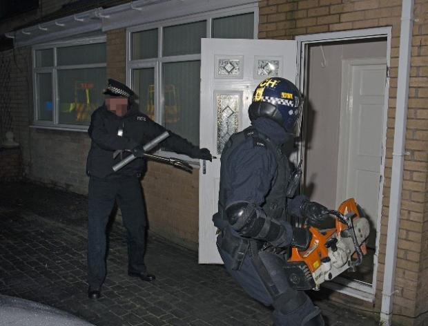 RAIDS: Matrix officers target a property this morning as part of a crackdown on organised crime.