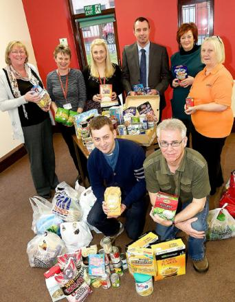 The foodbank team with donated items.